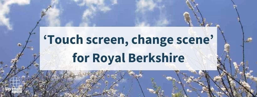 """Blog banner with text """"'Touch screen, change scene' for Royal Berkshire"""" in a white, semi-transparent box, in front of an LED sky ceiling design of white blossom flowers and blue skies"""