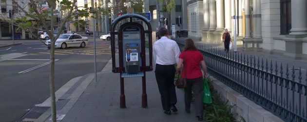 A tight squeeze around the public phone outside St Vincent's Hospital- Jonar Nader