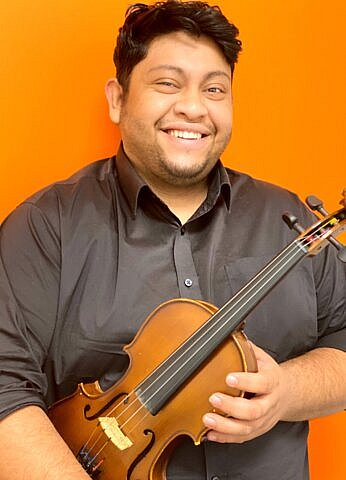 Oscar Martinez, strings instructor at Center Stage Music Center