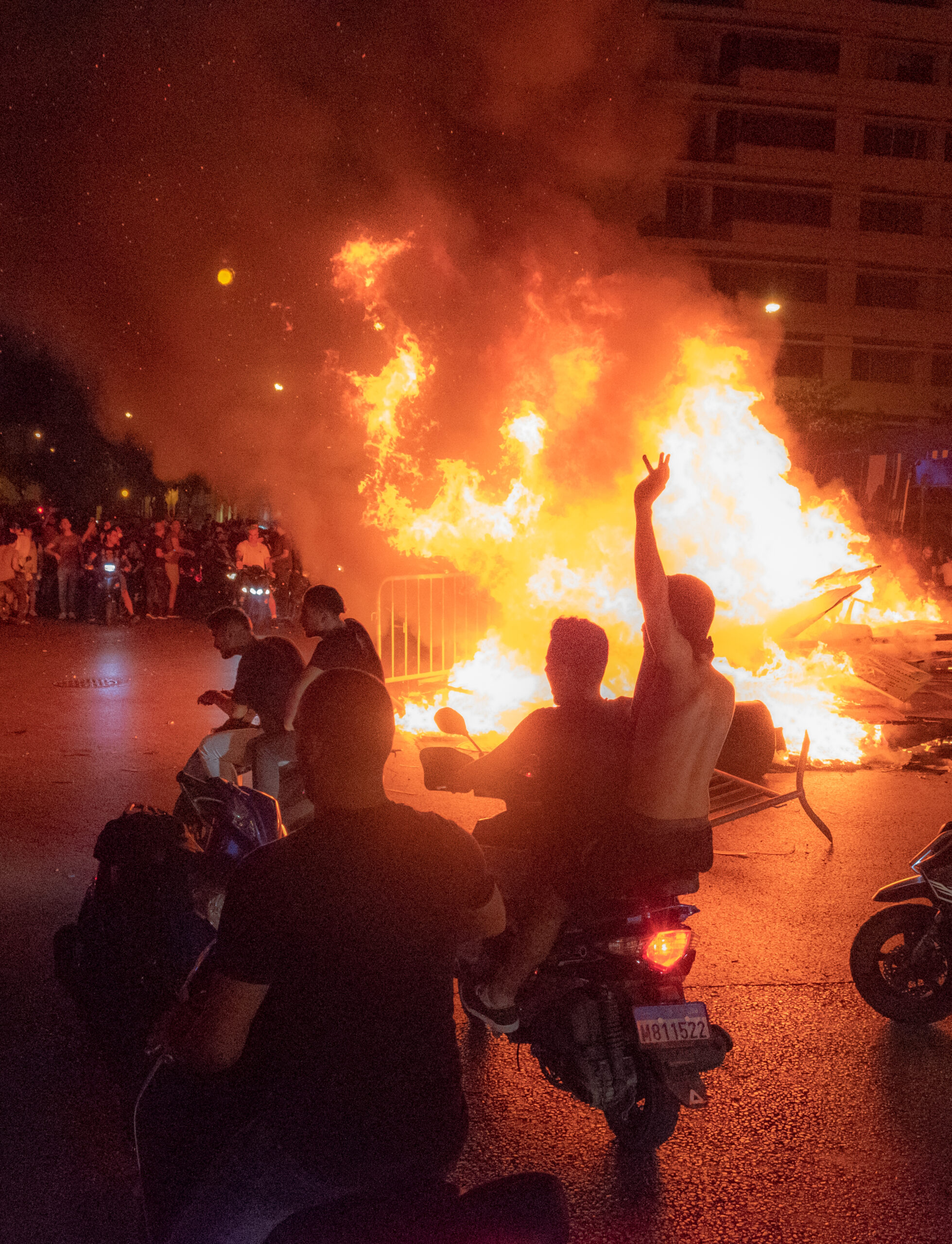 Beeping motorcycles going around the fire pit in Downtown Beirut. 17 October 2019.
