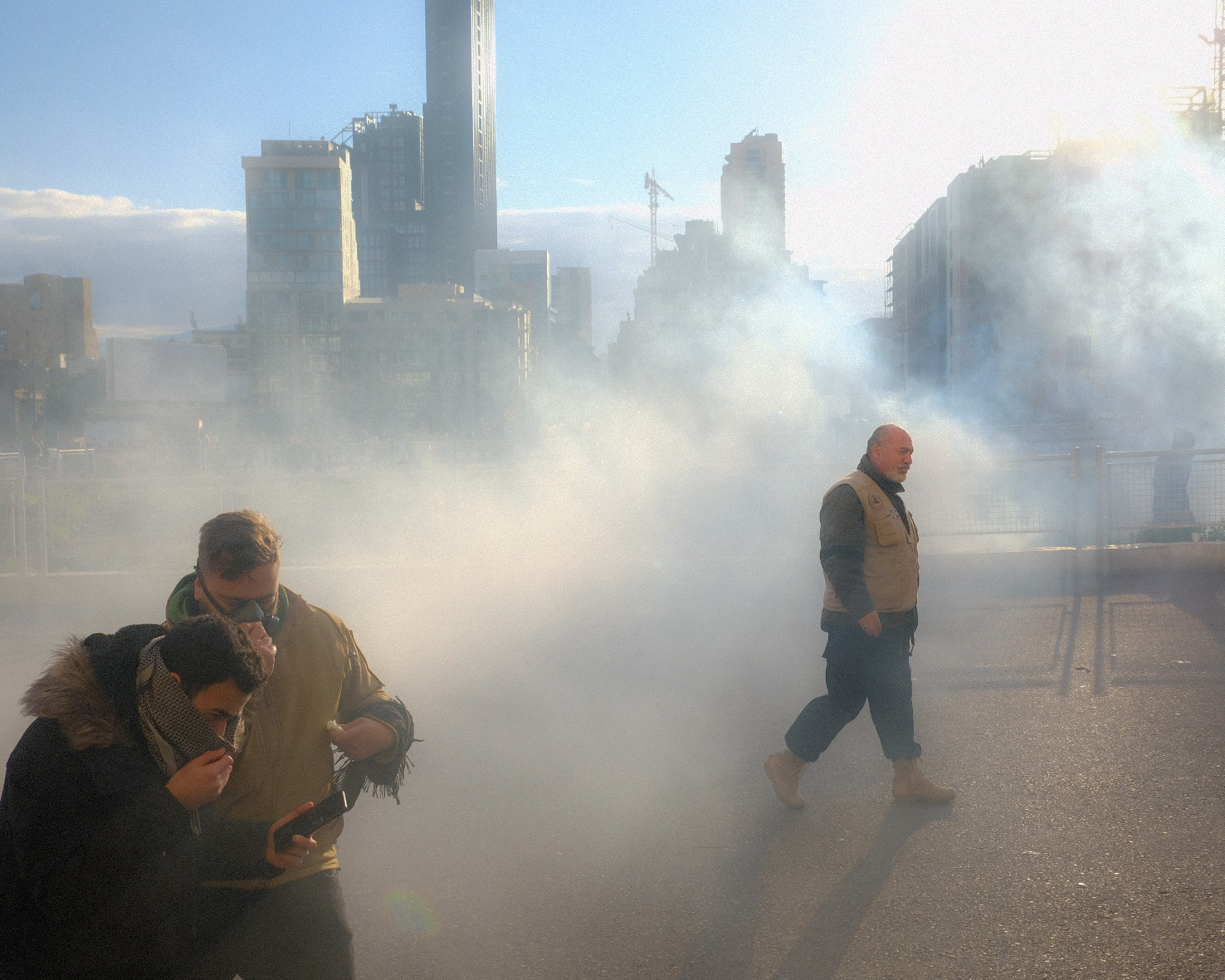 Protesters running from tear gas on the day of Parliament's confidence vote.  11 February 2020.