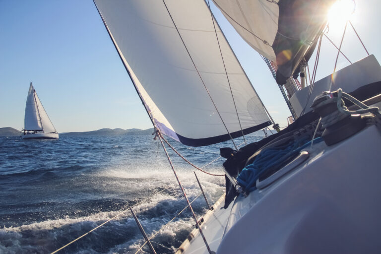 A monohull sailing yacht heeled over