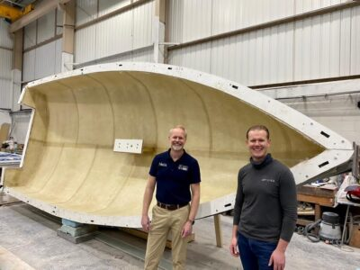 Hein Kuiper of Boats on Wheels and Tommi Buckley of Buckley Yacht Design in front of the mould of the latest BTC22 under construction