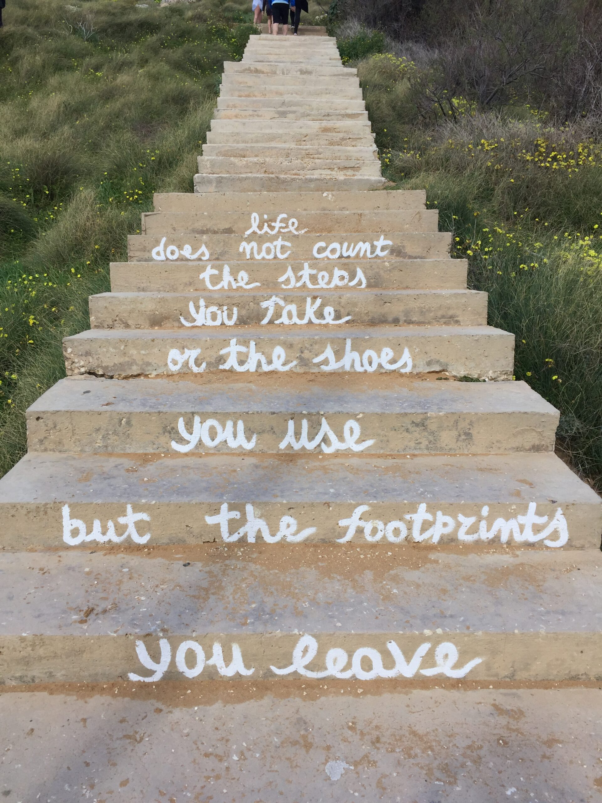 Little motivational quotes on the stairs of the beach