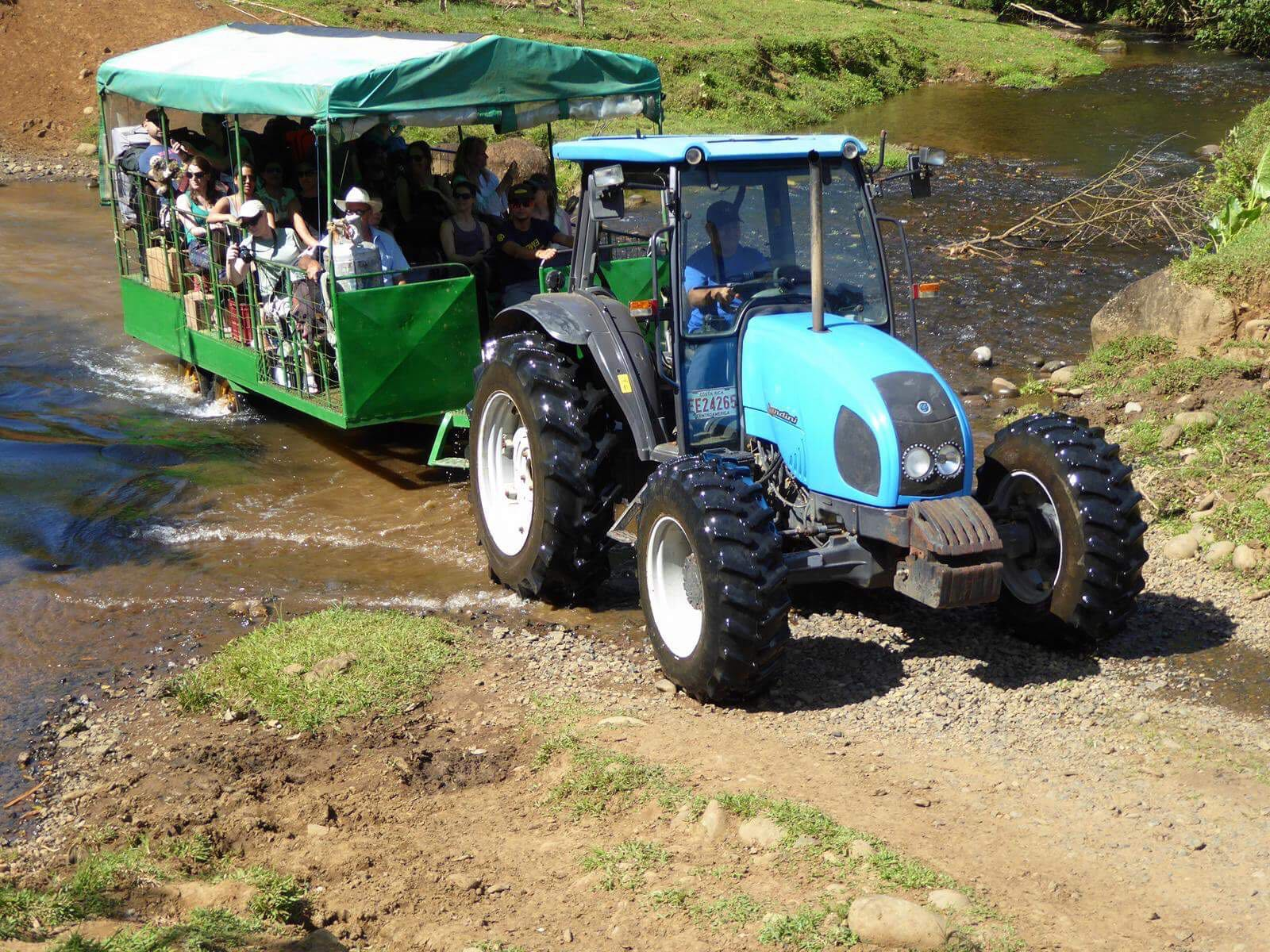 Tractor ride to our rainforest lodge