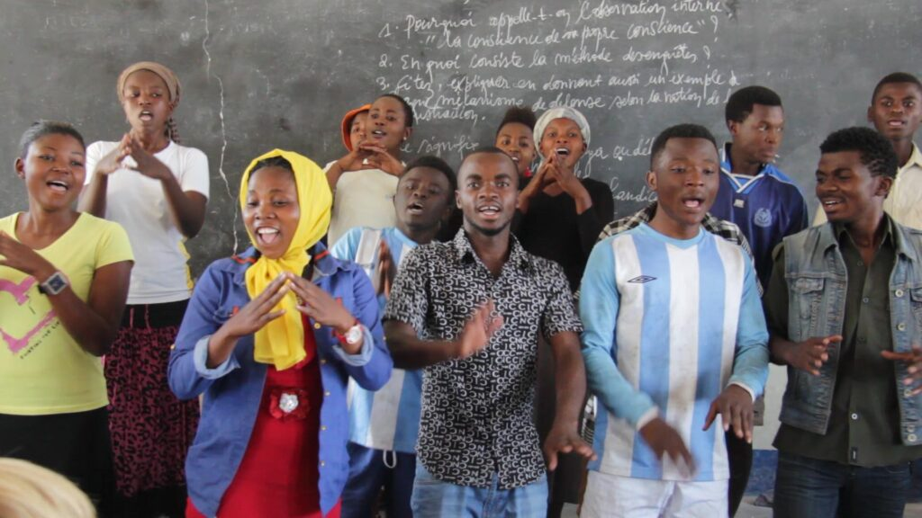 Children of liberty singing a song in class