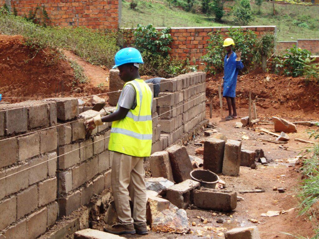 Men building a wall.