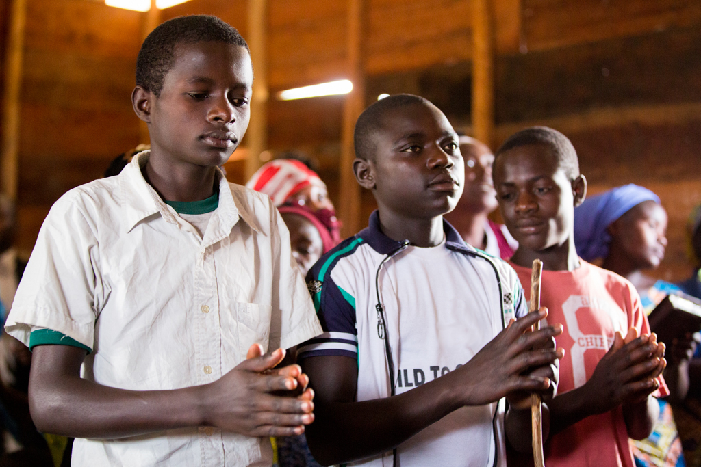 A group of teenage boys praying