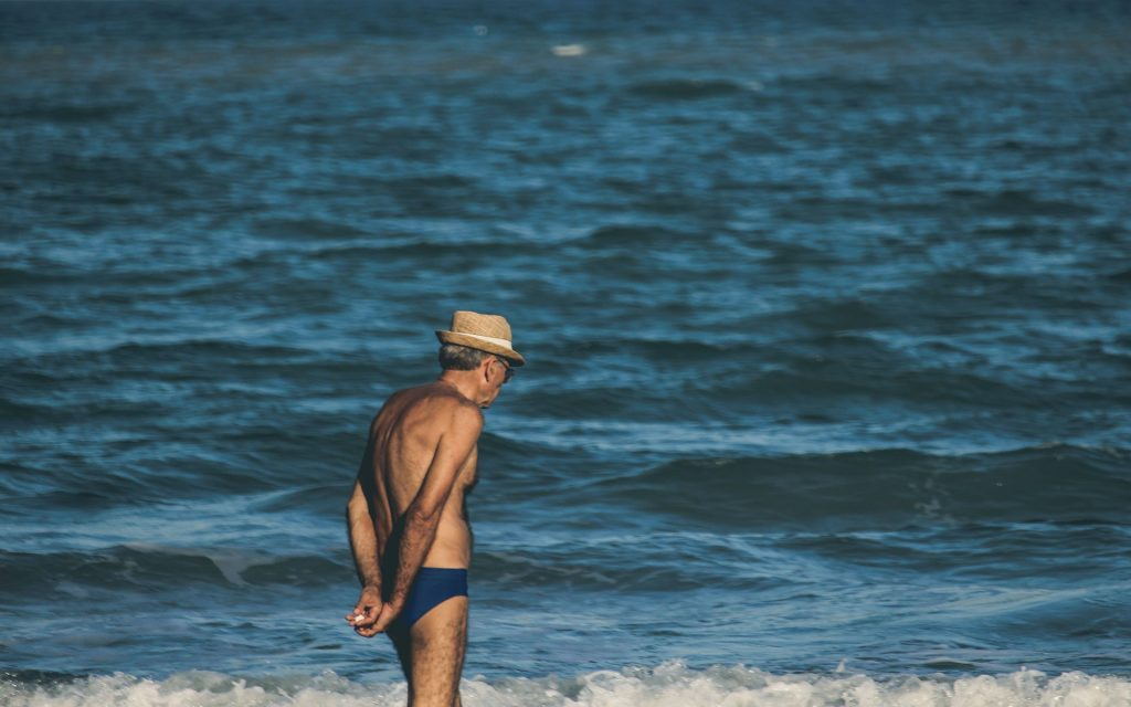 Older traveller by the sea