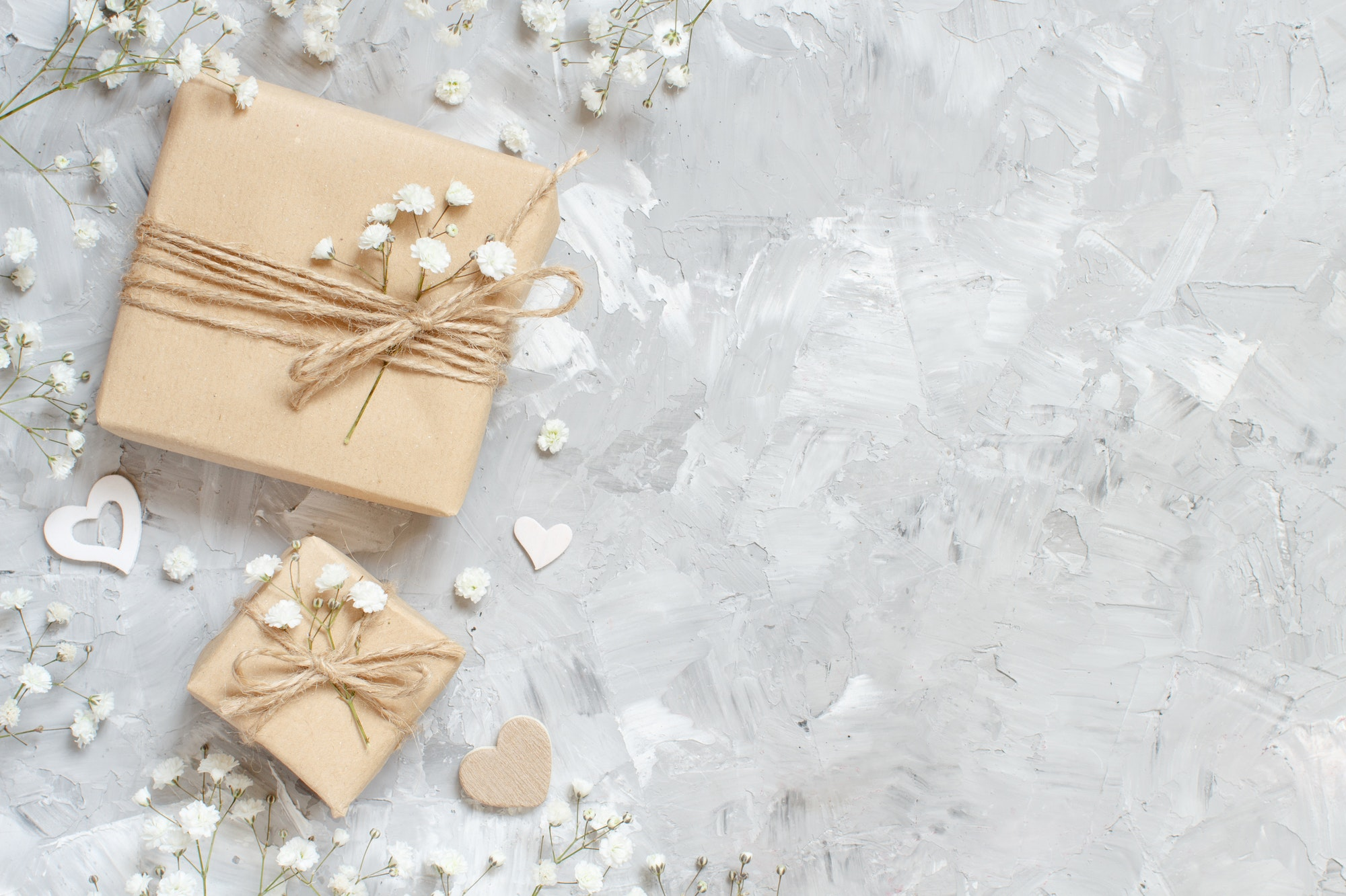 Gift boxes with small white flowers