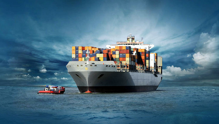 A large container ship packed with containers being assisted buy a tug boat in the open sea