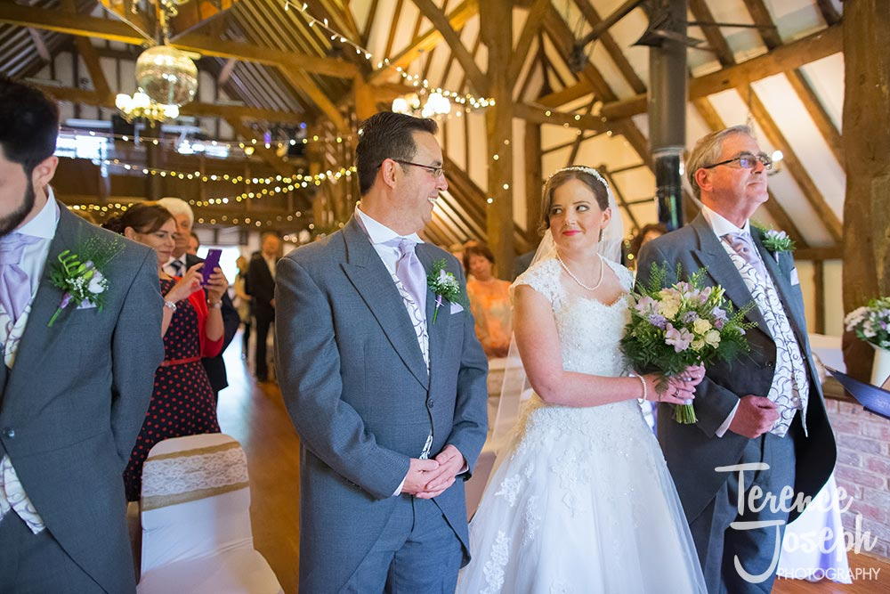 Beautiful bride and groom looking at each other at The Plough at Leigh