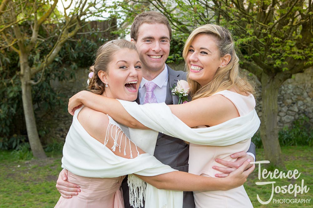 Groom and his happy sisters
