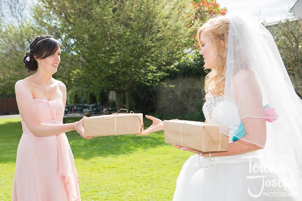 Bride gives gift to sister
