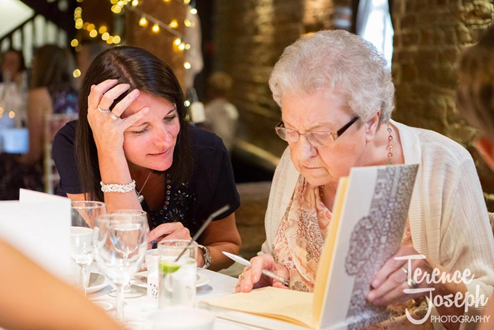 Grandmother reading wedding notes