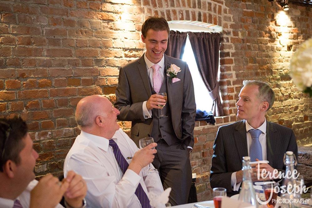 Groom speaking to the friends at wedding breakfast