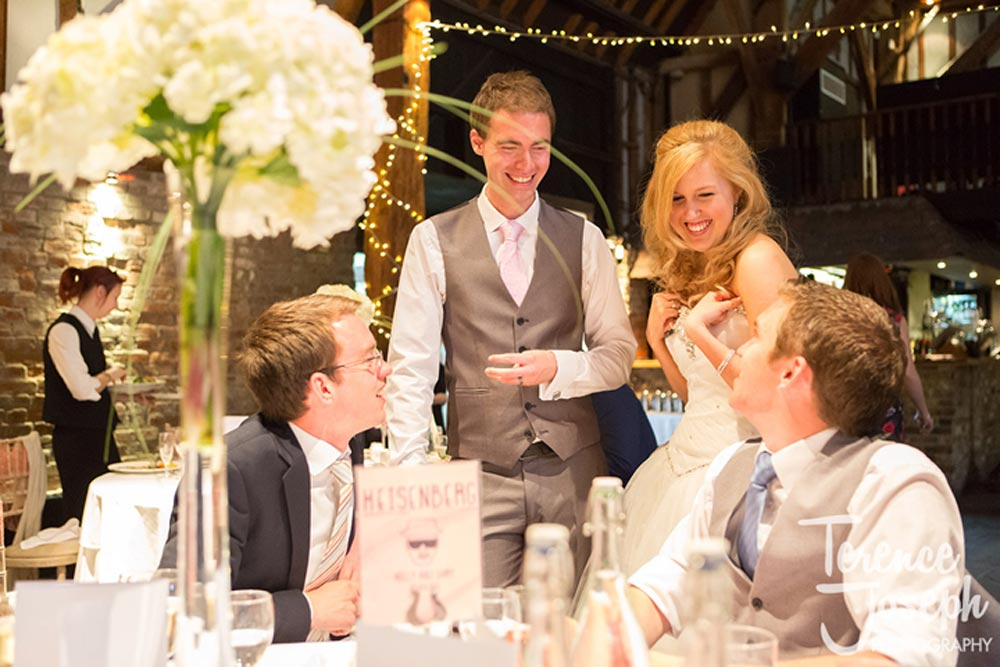 Bride and groom speaking to wedding guests after gift