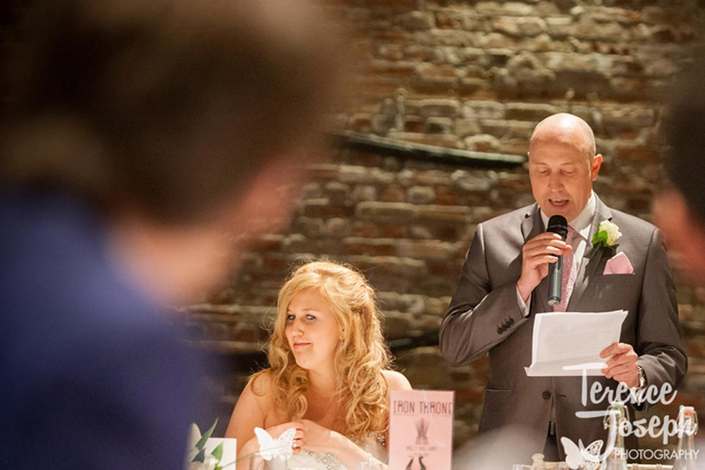 Father of the bride speech while bride looks amused