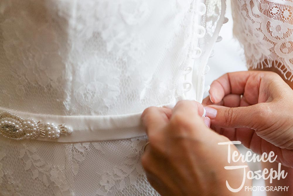 Wedding dress being fitted at Oakwood House in Maidstone