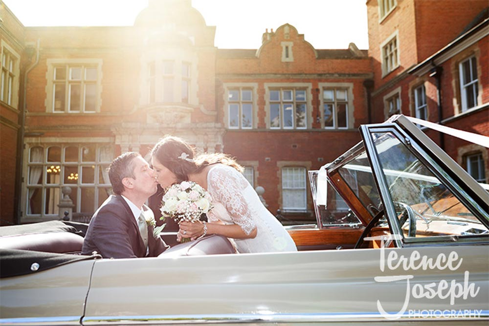 Wedding portraits with wedding car at Oakwood House in Maidstone