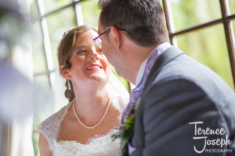 Bride looking at groom lovingly