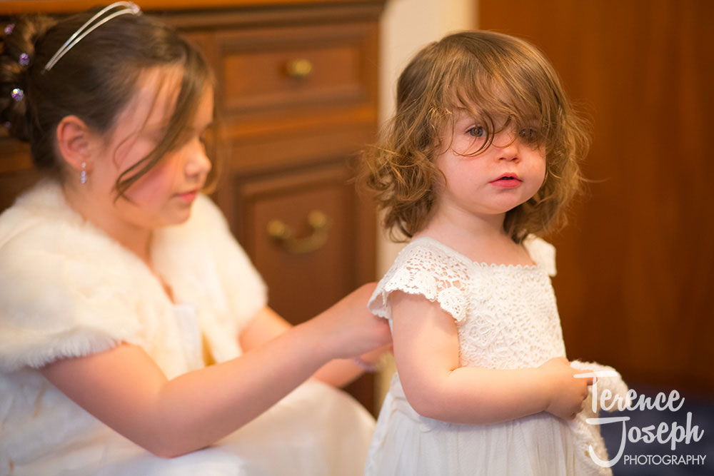 Cute little girl getting ready for wedding ceremony by Terence Joseph Photography