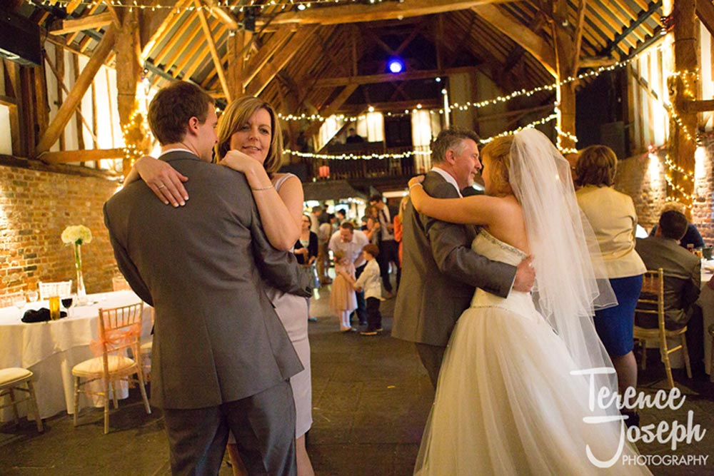 Parents dance with newly weds