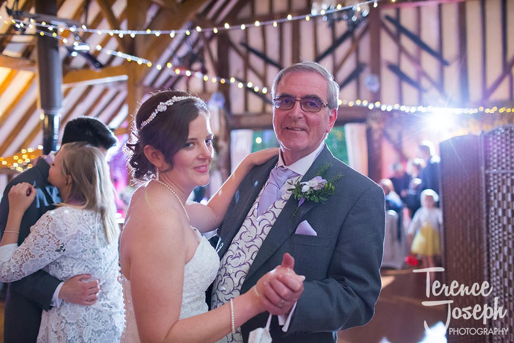 Father having dance with bride