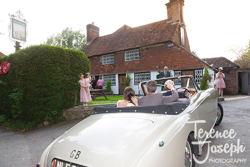 Newly weds arrive at The Plough at Leigh wedding reception