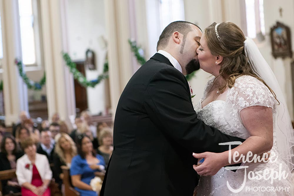 First kiss of bride and groom in London