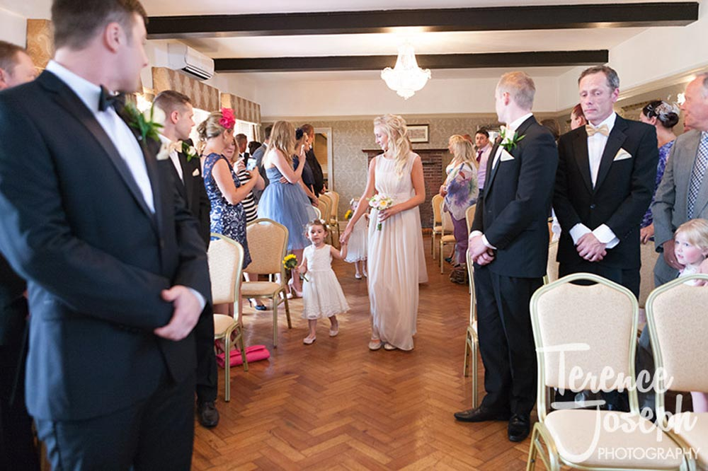 Bridemaids walks down the aisle at The Cavendish Eastcote