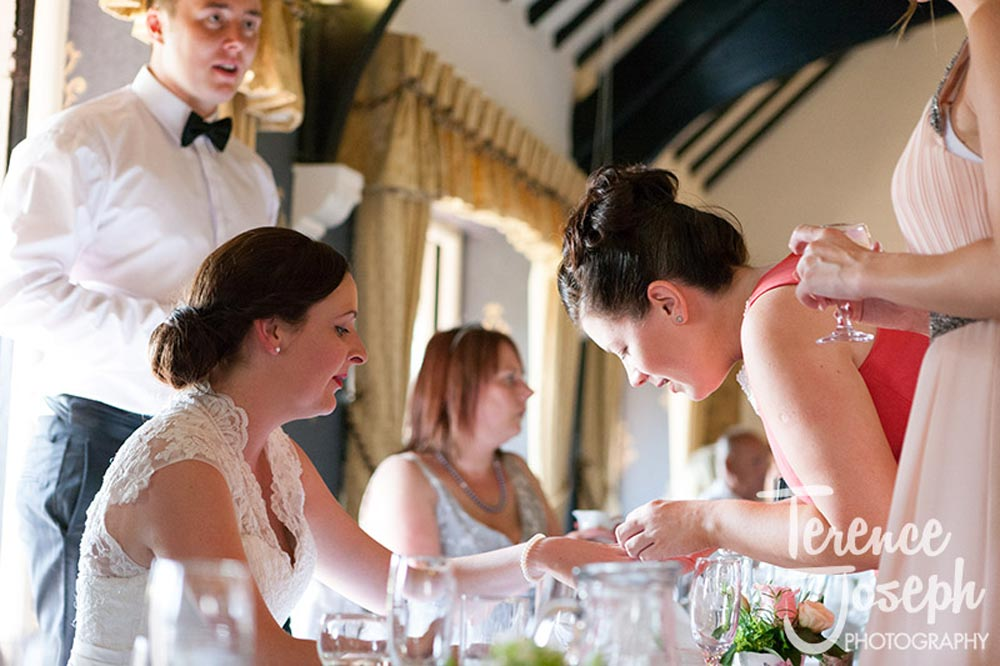 Admiring the wedding ring at Wedding Breakfast The Cavendish Eastcote