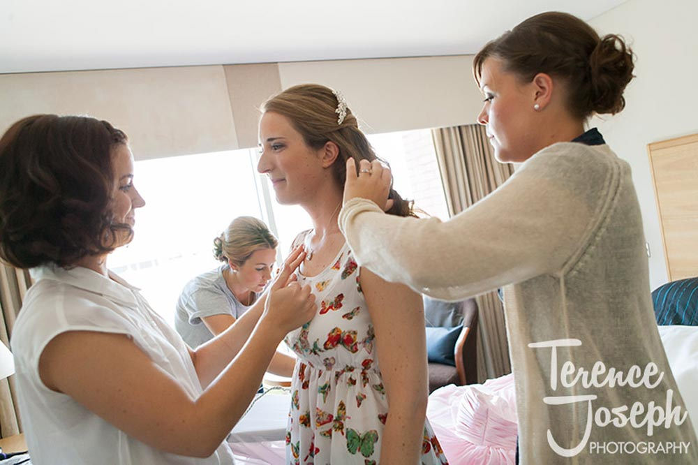 Bride getting her hair made up at Reading Wedding