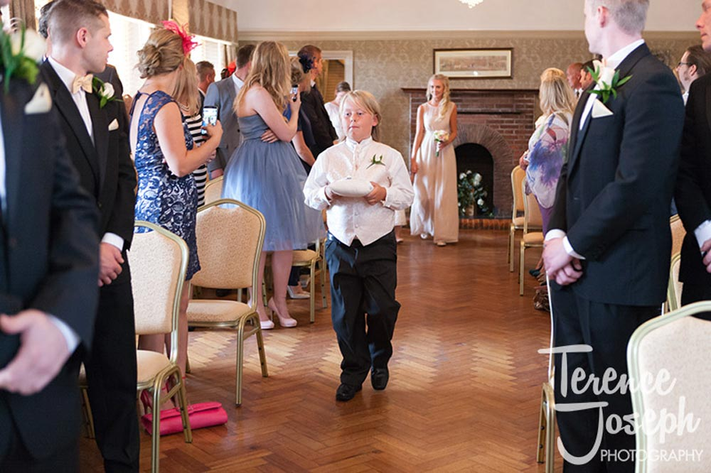 Page boy walks down the aisle at The Cavendish Eastcote