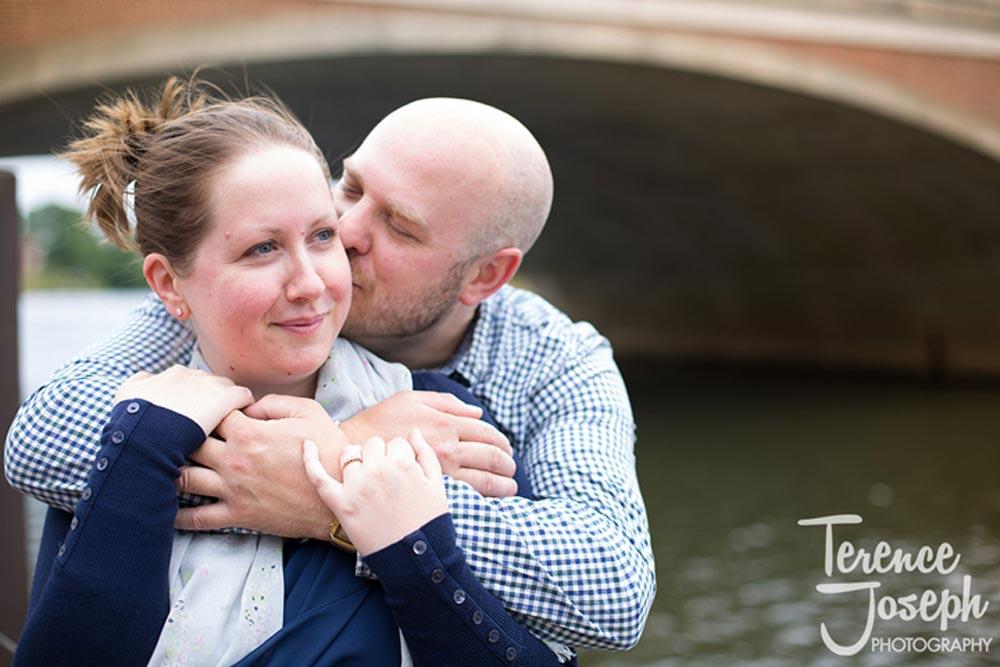 Cute couple under the bridge for engagement photos