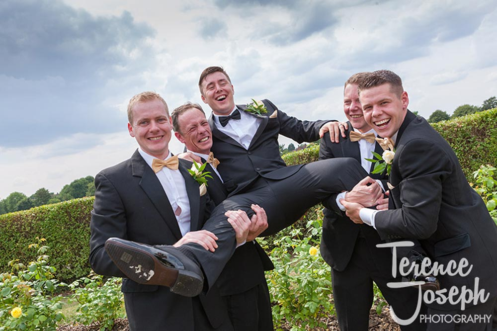 Groom and groomsmen celebrating at The Cavendish Eastcote