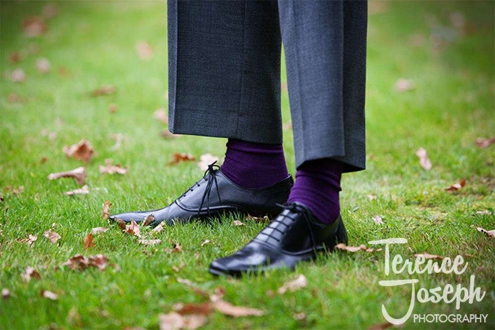 The groom has purple wedding socks