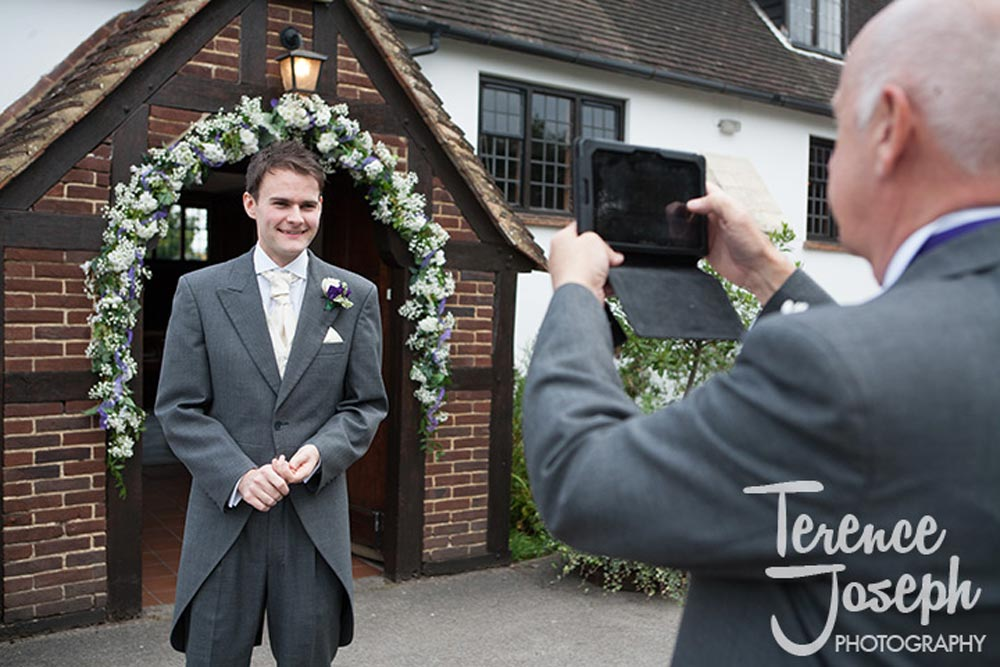 Groom photos outside Church in Reading