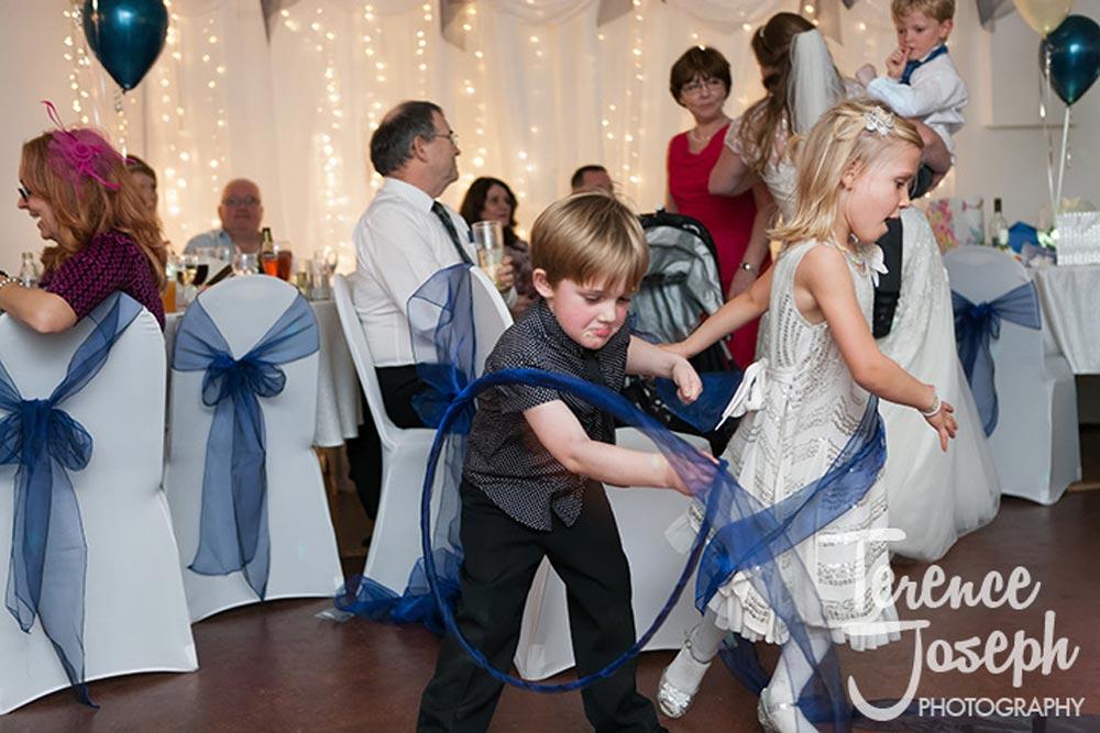 Kids having fun at the wedding reception