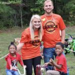 Cannon Hinnant's Family with two children receiving new bikes