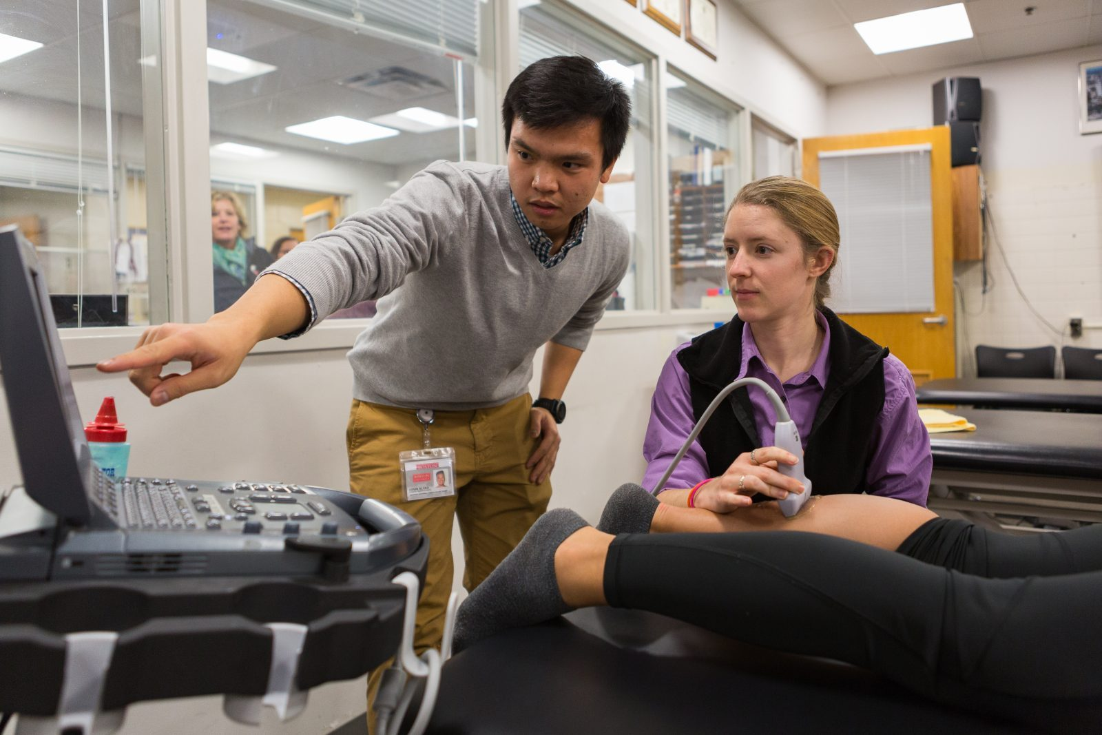Athletic Training Session With Diagnostic Instrument