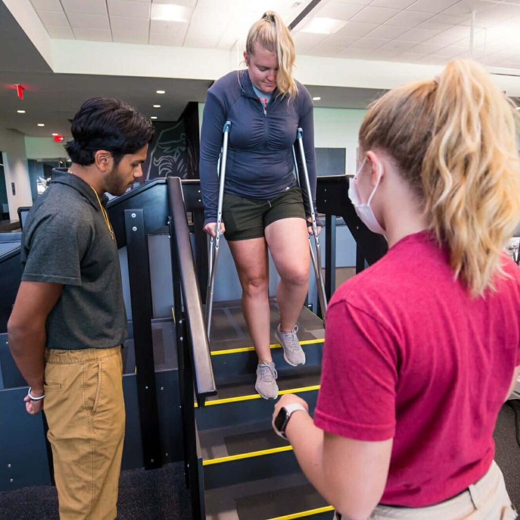 Athletic Trainers Monitor Student on Crutches