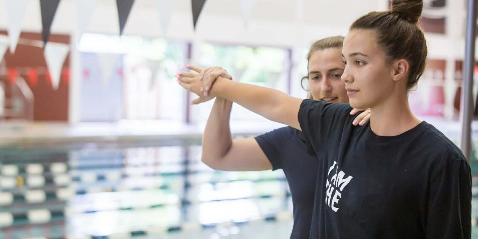 Athletic Trainer Positions Swimmer's Arm