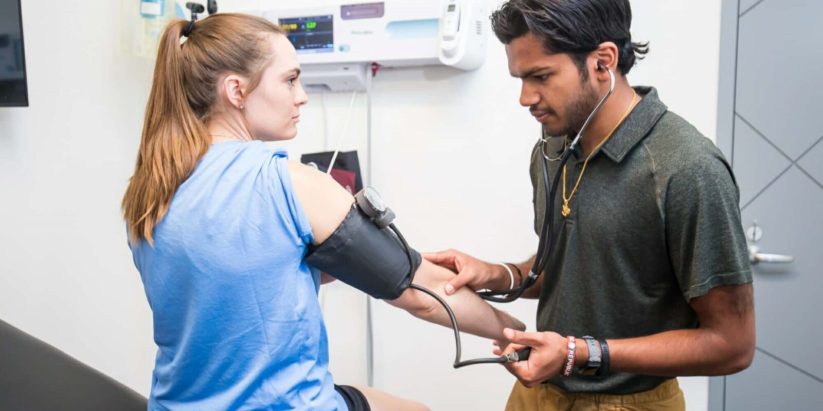 Athletic Trainer Takes Patient Blood Pressure