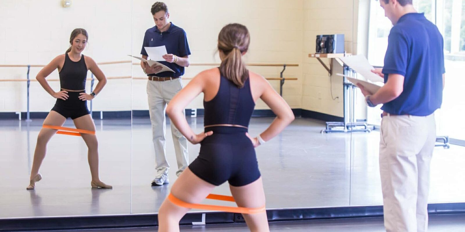 Athletic Trainer Working With Dancer