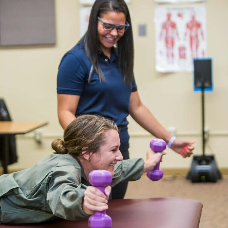Athletic Training Session With Hand Weights