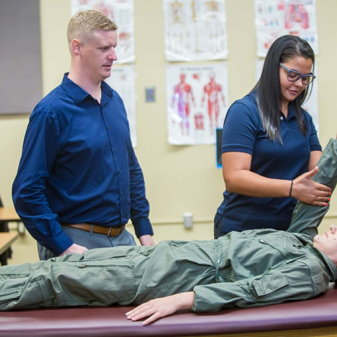Trainers Working With Military Patient