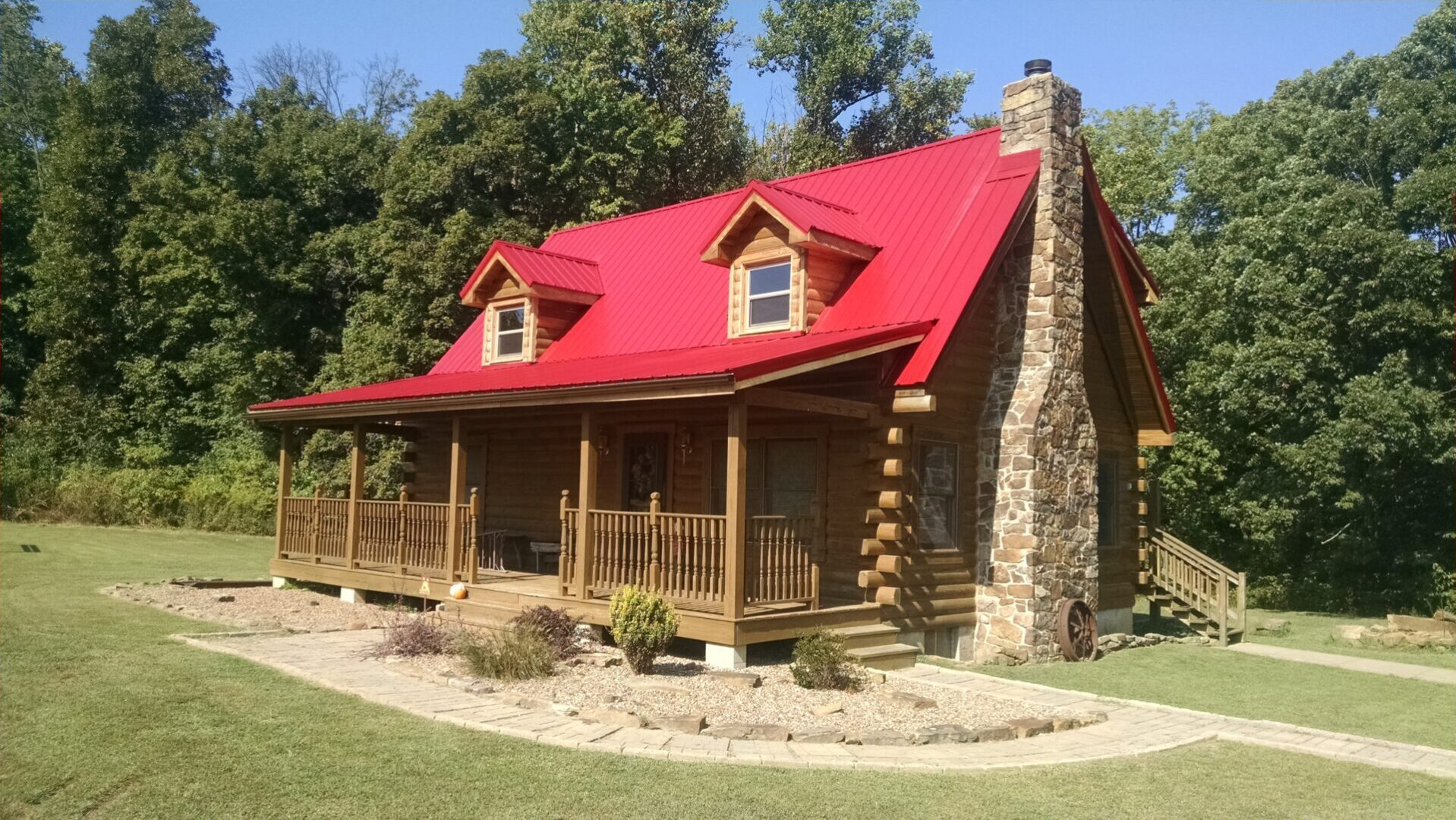 A cabin with a red roof