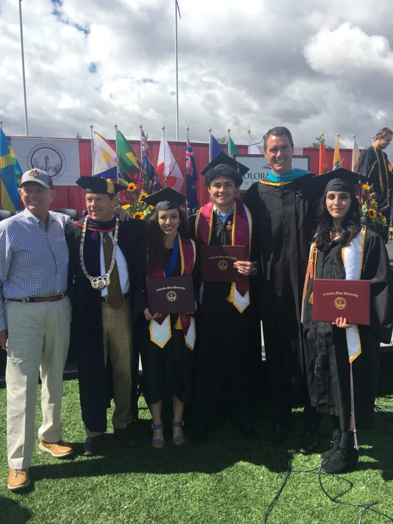 scholars holding diploma