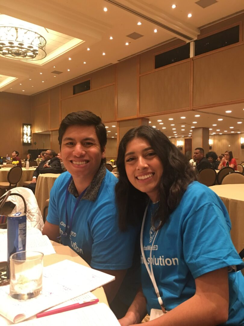 man and woman wearing blue shirt